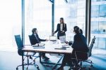 male and female executives in a boardroom